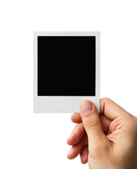 Male hand holding blank instant photo frame, clipping path inclu
