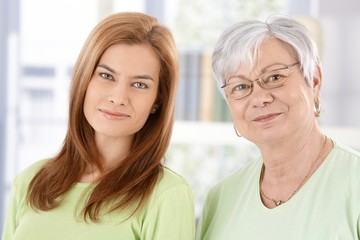 Closeup portrait of senior mother and daughter