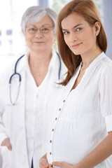 Portrait of pregnant mother and doctor