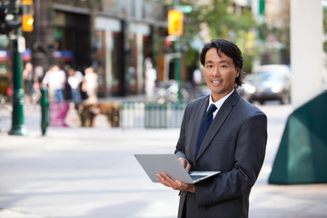 Business Man Portrait Outdoor with Laptop