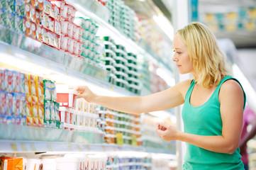 woman making dairy shopping