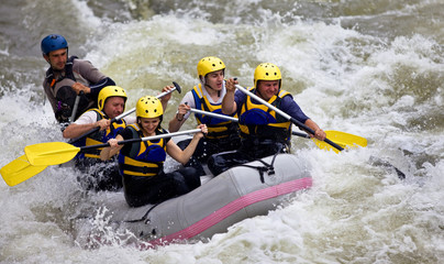 Group of people whitewater rafting Wall mural