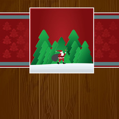 christmas card with santa claus in forest with sack
