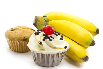 Fototapete - cup cake and bunch of bananas on white background