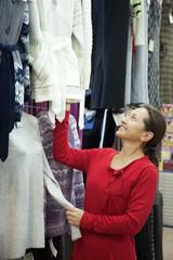 Mature woman  chooses clothes