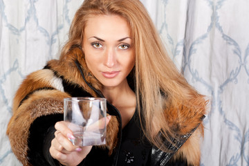 Pretty brunette girl with an empty glass