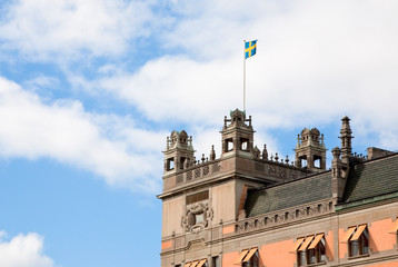 Swedish flag on roof of old house in Stockholm