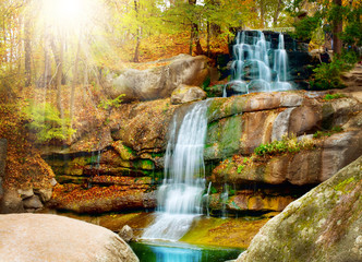 Waterfall in forest. Autumn