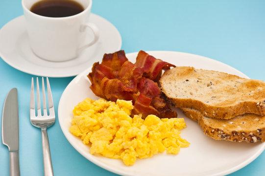 American breakfast, bacon scrambled egg and coffee