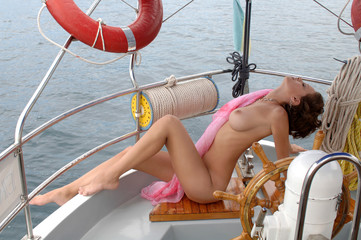 naked woman on a yacht