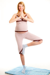 pregnant woman on a light background doing exercises