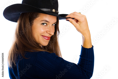 Friendly country girl with a cowboy hat