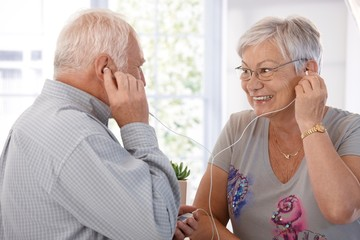 Elderly couple listening to music on mp3 player