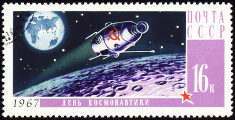 Post stamp with russian spaceship on Moon orbit