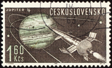 Postage stamp with Planet Jupiter and spaceship