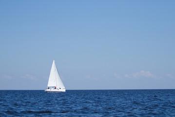 Sailboat sailing with blue sky