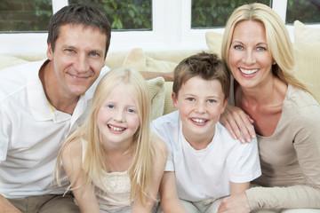 Happy Family Having Fun Sitting At Home