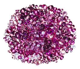 Many small ruby diamond (jewel) stones heap isolated on white