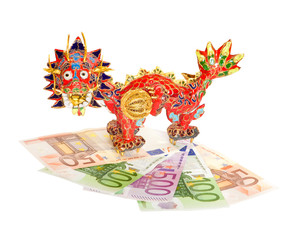Traditional Chinese red dragon on euro banknotes isolated