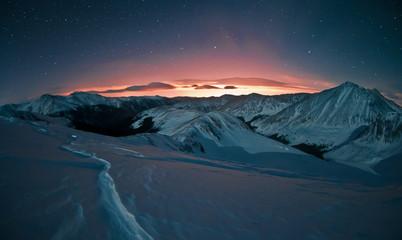 Denver Glow And Snow Covered Colorado Mountains