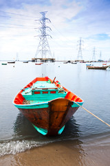 fishing boat with power plant background