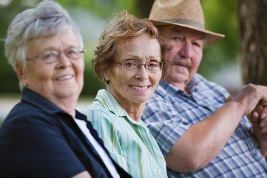 Senior friends sitting together in park