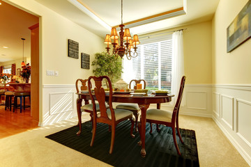 Elegant dining room with decorated table for fall dinner