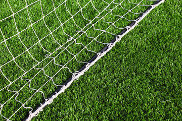 net for football lying on artificial grass of football field