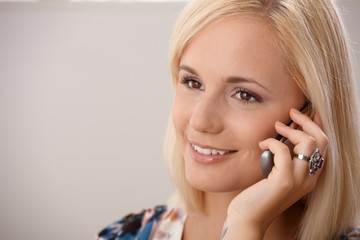 Portrait of blond woman on phone call