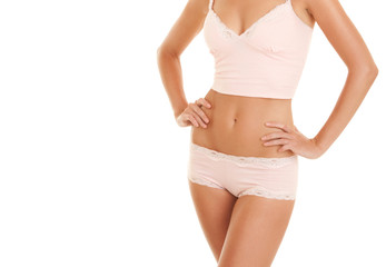 Tanned woman body in lingerie isolated on white background