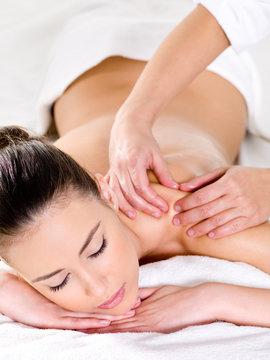 Beautiful woman having massage on shoulder