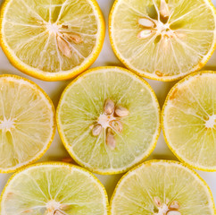 Lemon pieces on white background