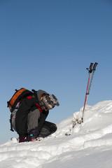 Young man preparing for ski