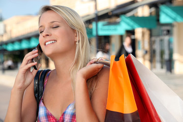 girl on the phone after shopping frenzy