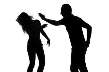 Silhouette of a man slapping a woman