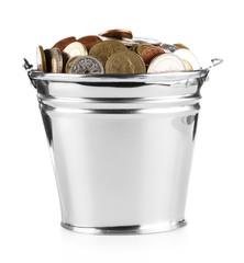 bucket full of coins over white