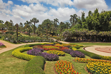 Magnificent flower beds, green lawns and tropical trees