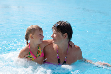 girl with grandmother in the swimming pool