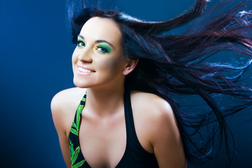 beauty smiling woman with dispelled hair