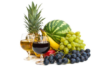 The group of fruits and two glasses of wine