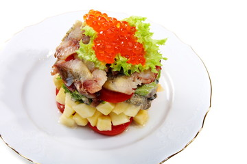 Salad with smoked herring and salmon roe.