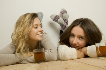 Two attractive friends drinking tea