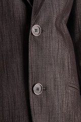 Knöpfe am Anzug