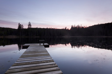 Fishing Pier on lake, sundawn