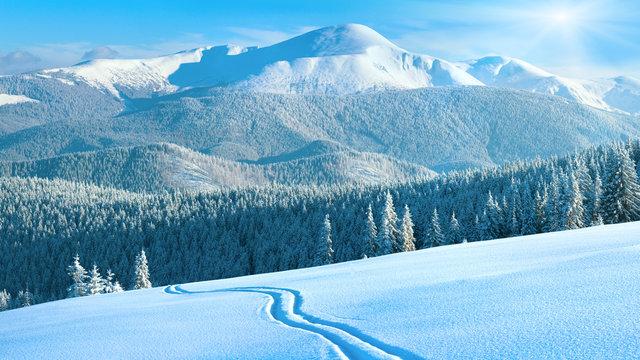 winter mountain panorama with ski track