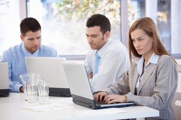 Young businesspeople working in meeting room
