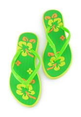 a pair of green beach sandals