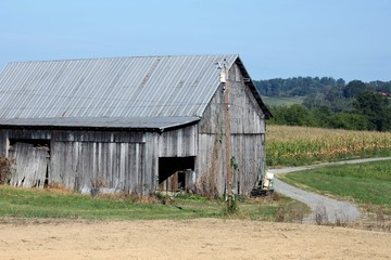 Old barn with winding country road