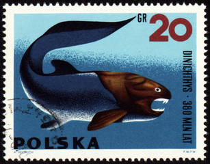 Prehistoric fish Dinichthys on post stamp