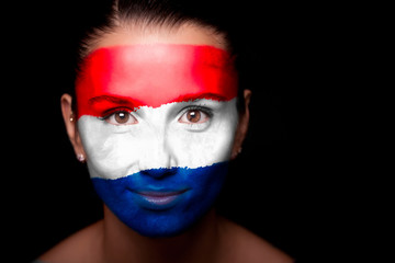 Portrait of a woman with the flag Netherlands
